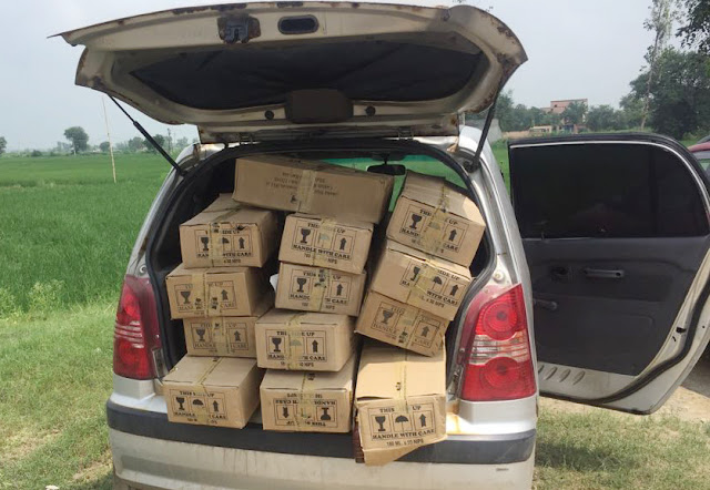 Palwal police caught an illegal national liquor laden car, the driver absconded