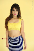 Cute Telugu Actress Shunaya Solanki High Definition Spicy Pos in Yellow Top and Skirt  0108.JPG
