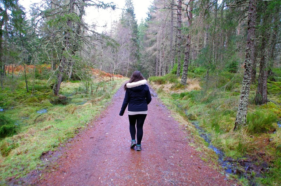 Girl hiking through Scottish Highlands