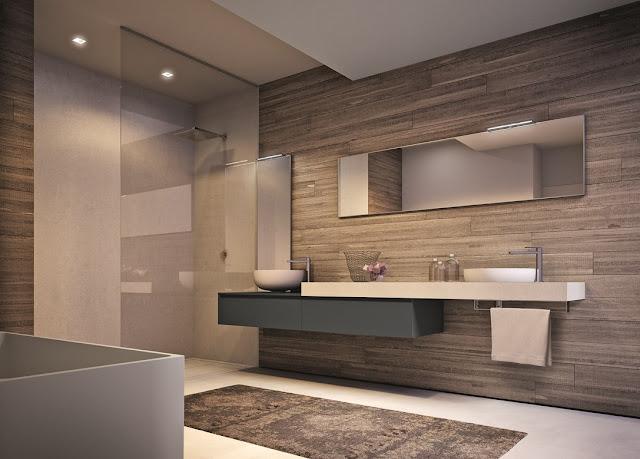 Piatto doccia in resina filo pavimento abbinato al lavabo d'appoggio in resina per un bagno di design
