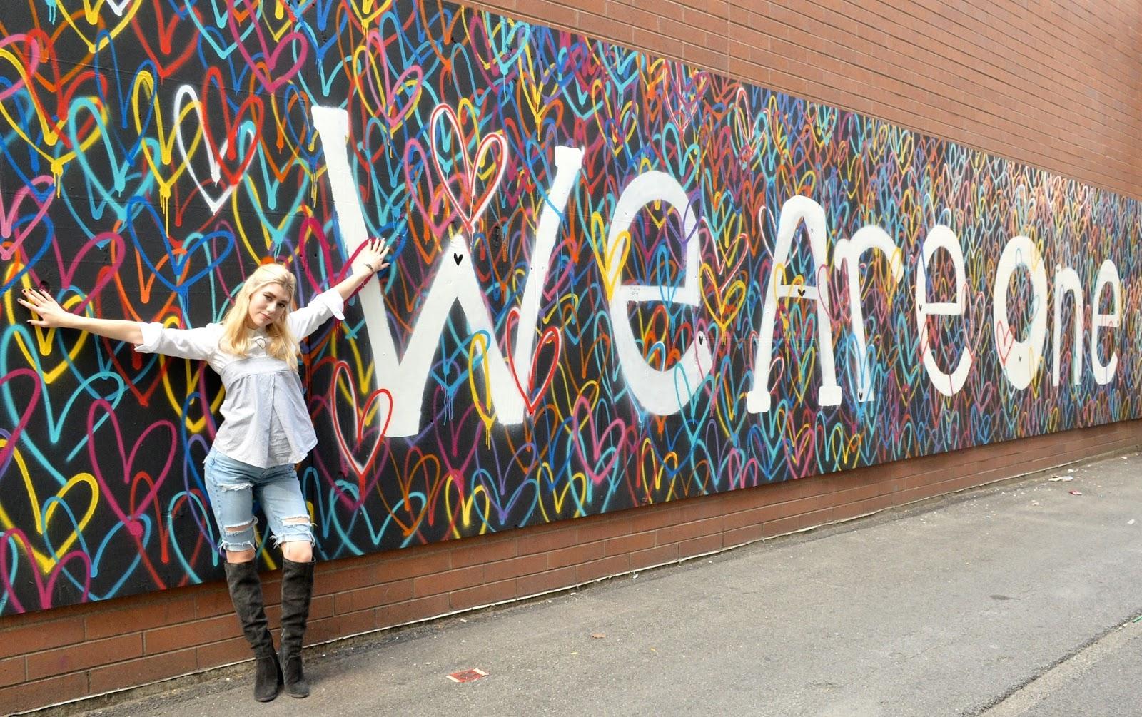 Hugging a bleeding heart mural in chicago.