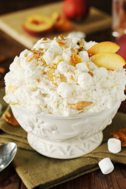 Peach Fluff Salad ~ A bowlful of creamy peachy comfort!  Made with peach pie filling, it's quick & easy to prepare ... and makes one fabulously tasty fluff.   www.thekitchenismyplayground@yahoo.com