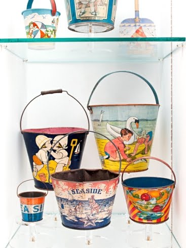vintage beach sand pails on shelf