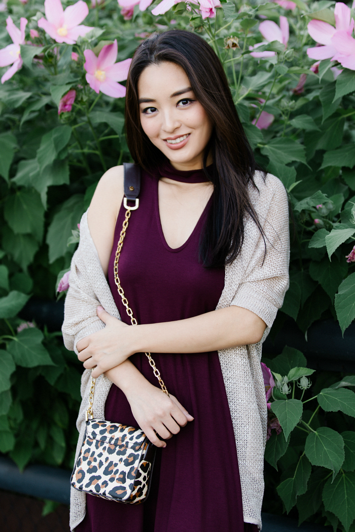 animal print bag and burgundy dress