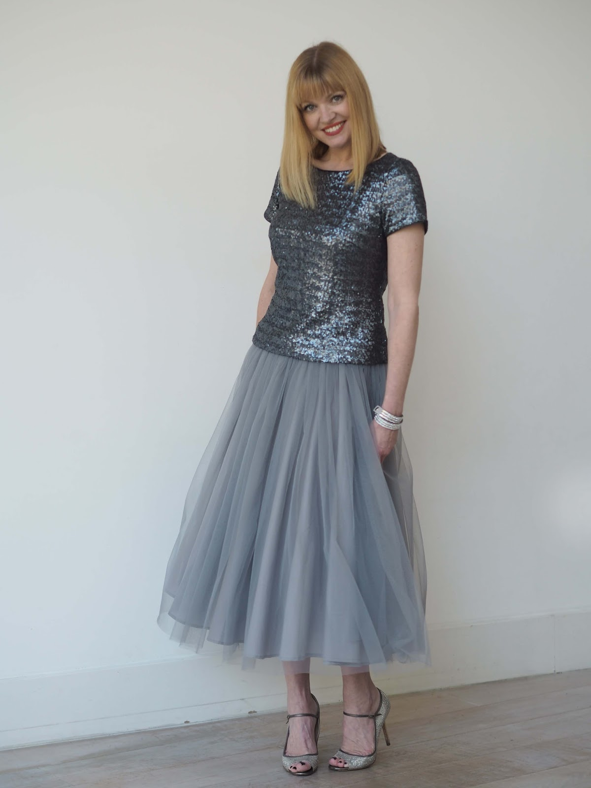 Grey tulle skirt with sequin top and Jimmy Choos, over 40 style