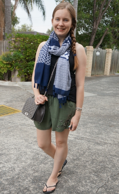 navy geometric mixed print tassel scarf with olive shorts and grey quilted Love bag Rebecca Minkoff | away from blue