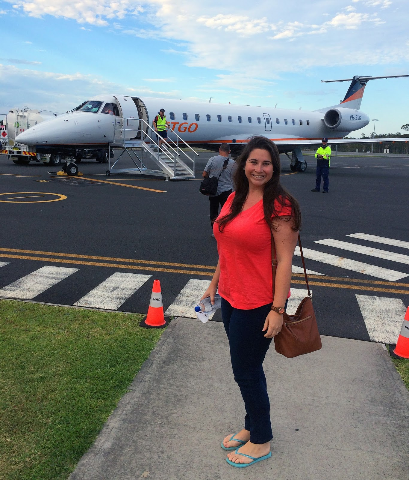Girl boarding JETGO Australia Plane in Port Macquarie to Essendon