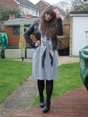 97e20e62733 Grey midi dress complete with black skinny belt  Primark Pleather hooded  jacket  Topshop Cameo print scarf  Primark Back tights  Primark Leather  heeled ...