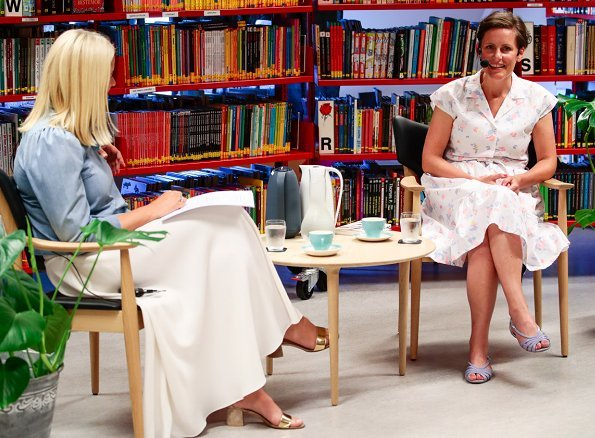 Princess Mette-Marit wore Ulla Johnson Wes bow embellished denim blouse. Crown Princess talked with Author Monica Isakstuen at Egersund library