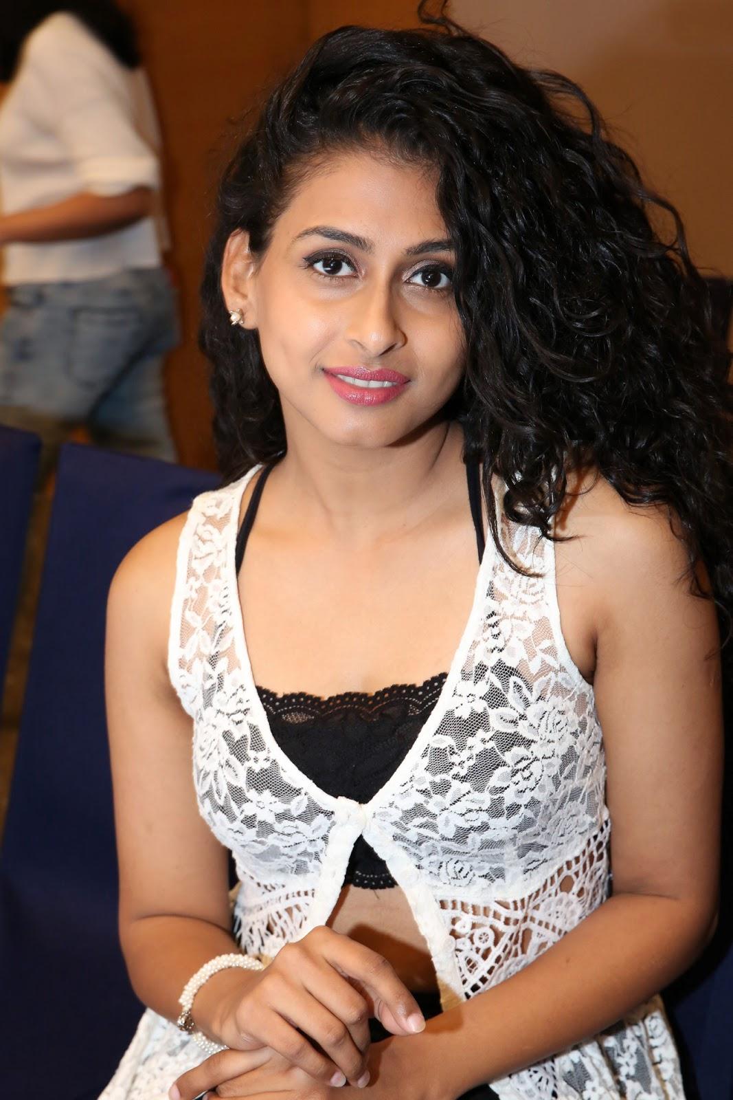 Nitya Naresh in Short Black Mini Skirt and Tank Top at Sutra Function
