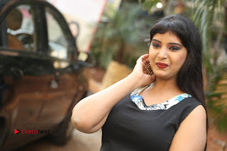 Actress Model Poorni Stills in Floral Long Dress at Silk India Expo Launch  0033.JPG