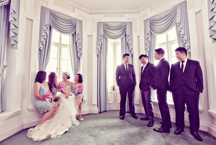 gentlemen and bridesmaid sitting on the window pane