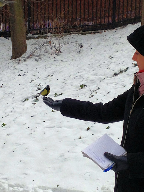 A touching photo of our author sharing a moment with one of the birds in Łazienki Park.