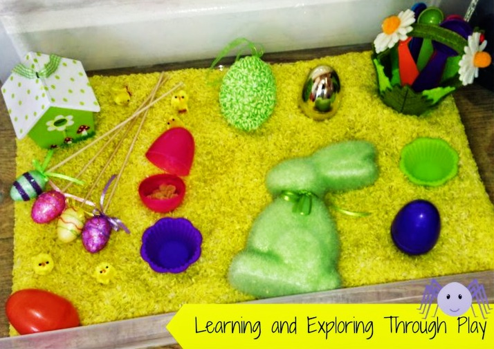 Spring sensory bin made with yellow rice, a green foam Easter bunny, Easter eggs both foam and plastic, a flower bucket, and a bird house.