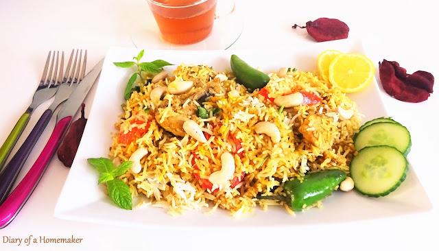 nawabi-biryani-Indian-cuisine-main-dish-rice-tomatoes-garam-masala-red-pepper-fried-onions-kewra-screwpine-cashews-almonds-sesame-seeds-lemon-mint-green-pepper-cloves-cinnamon-chicken-pilaf-entree-