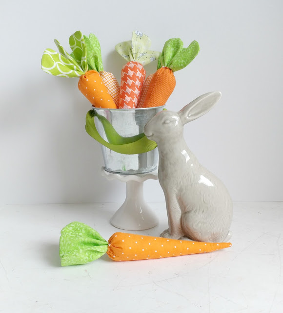 Add fabric carrots to a bucket and use as a decoration with a bunny for spring or Easter.