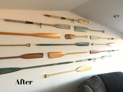 Vintage oars on the wall.