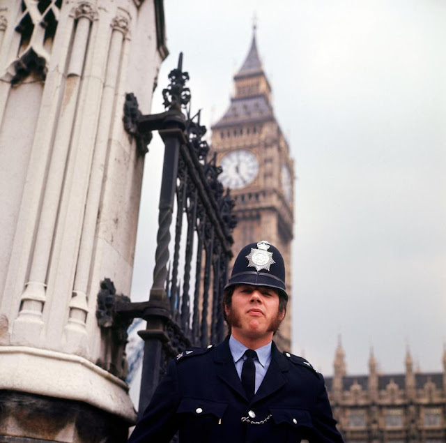 A Bobby outside Big Ben in 1973. Police Aesthetics. marchmatron.com