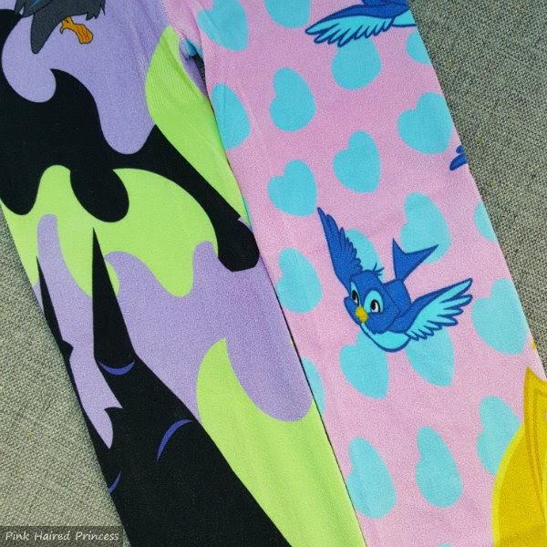 tights with purple green flame print on one leg and pink and blue heart print on other