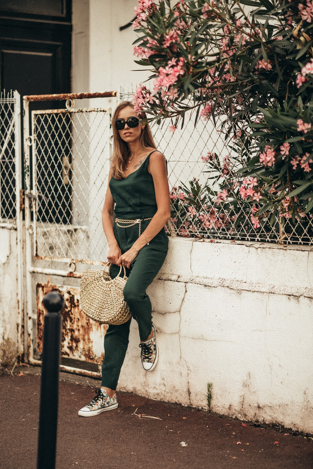 green jumpsuit straw bag summer outfit