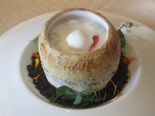 Chilled Almond Cream with Hashima served in Coconut