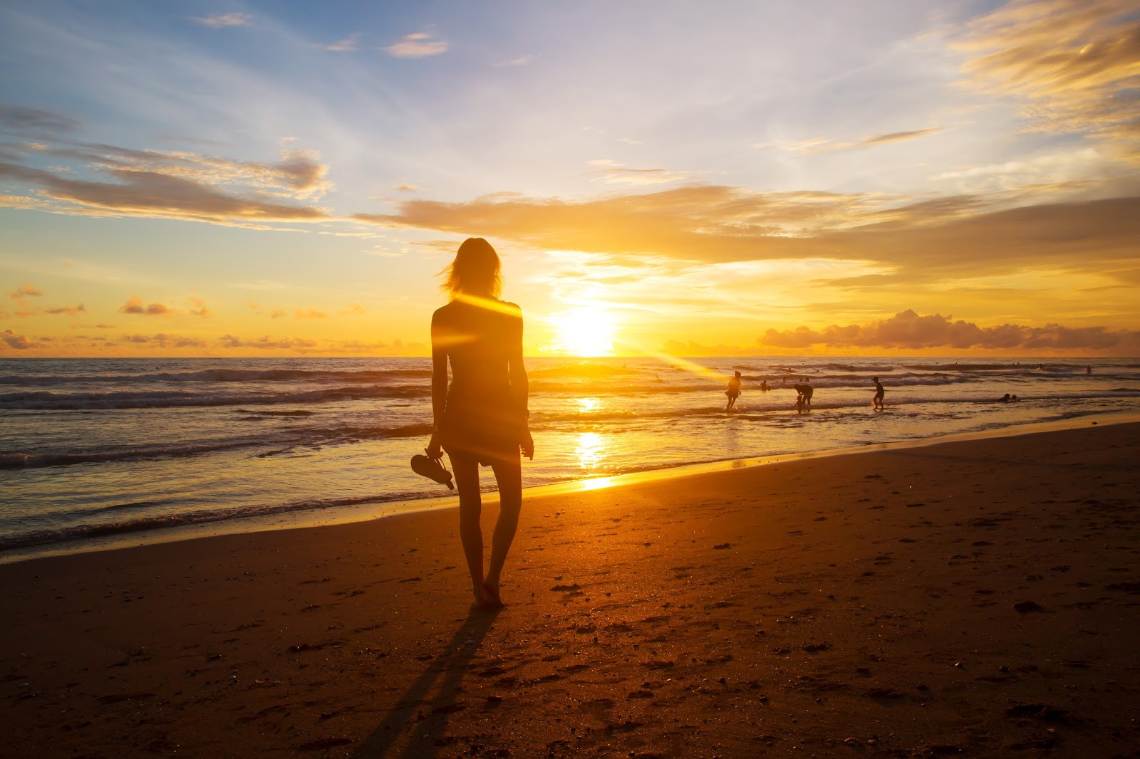 travel blogger, Alison Hutchinson, catching the sunset at Berawa Beach in Canggu, Bali