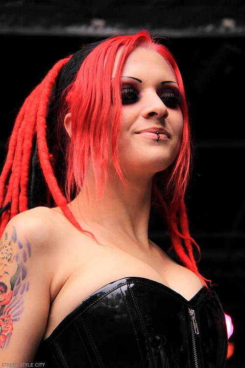 Beautiful dutch girl wearing black pvc corset and red hair.Trendy streetstyle fashion photography.