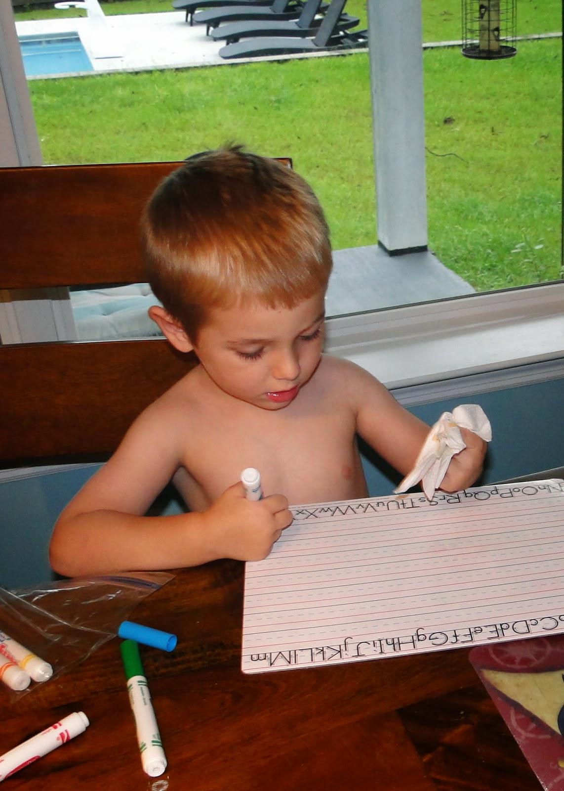 boy practicing writing