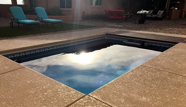 A fully in-ground Endless Pools swimming machine reflecting the sun in Tucson, AZ