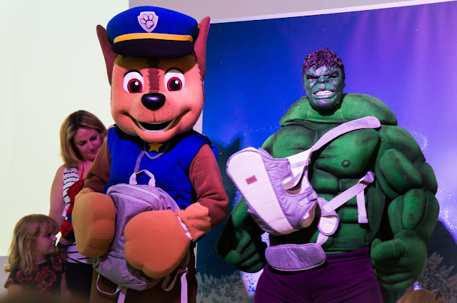 life size chase from paw patrol and the hulk both holding baby items