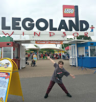 Boy standing at the gates of Legoland