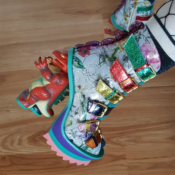 close up of dinosaur heeled shoes with floral uppers and colourful metallic straps