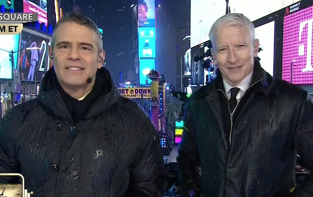 Drenched CNN hosts blast NYPD for banning them from having UMBRELLAS in Times Square security clampdown, as rain soaks Ball Drop and even grounds specially-commissioned police drone