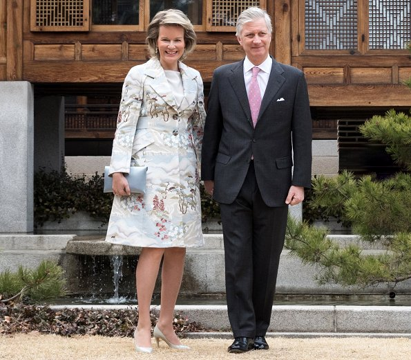 Queen Mathilde wore a green floral print coat by Emporio Armani, and Prive Armani grey satin floral coat, Armani bag and Armani pumps