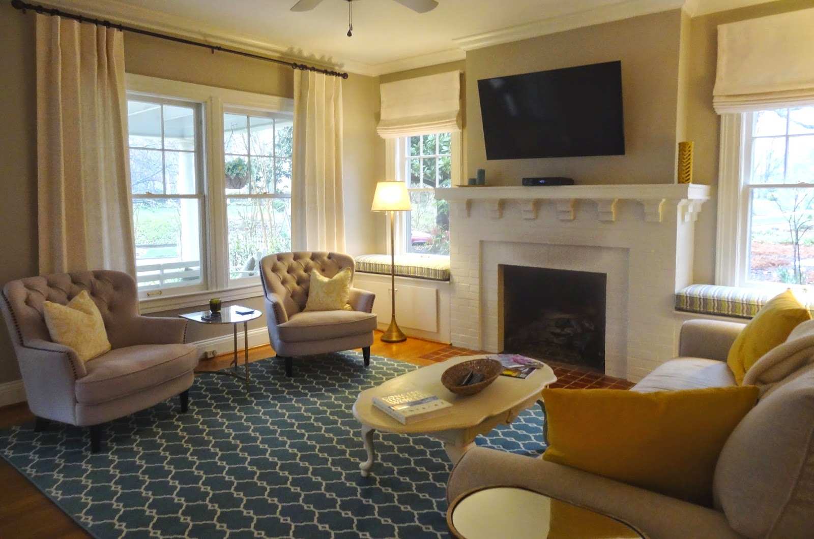 how to arrange living room with tv above fireplace recliner sofa sets what window treatments are best a seat ...