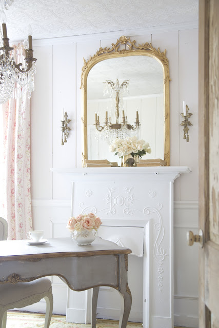 french style office with blush walls and gray desk