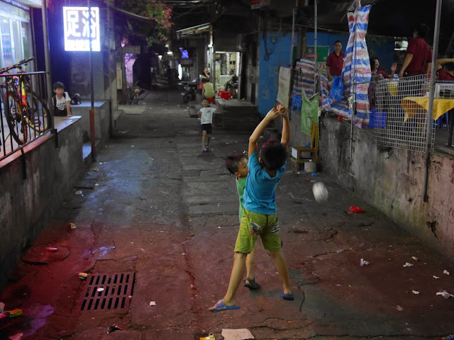 boy misses catching a paper ball in Zhuhai, China