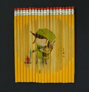 Dibujo usando como lienzo lápices.