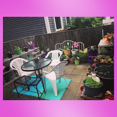 urban patio garden with upcycled furniture