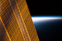 Earth and Solar Arrays of the International Space Station