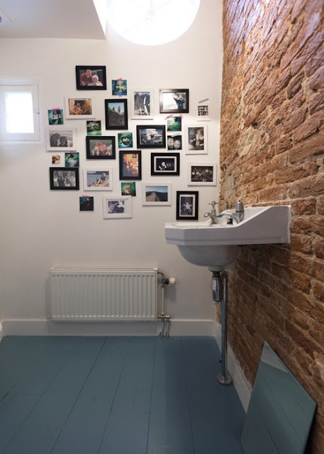 bathroom design idea with pictures on the wall