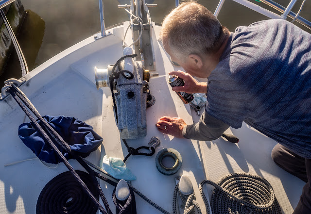 Photo of Phil cleaning the gypsy on Ravensdale's windlass