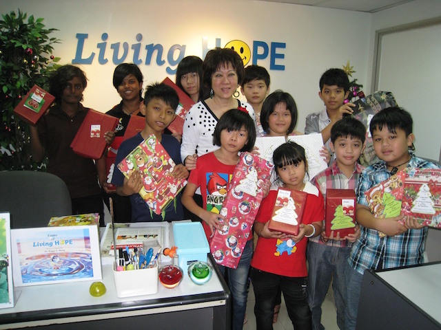 Children of Segamat Home receiving their Christmas Gifts