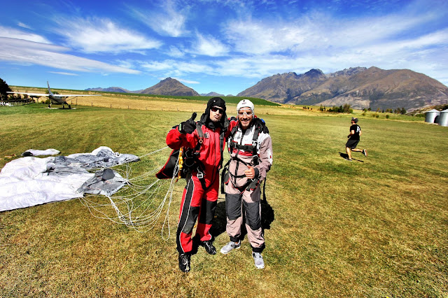 Celebrating with Greg, my tandem master, after skydiving from 15,000ft