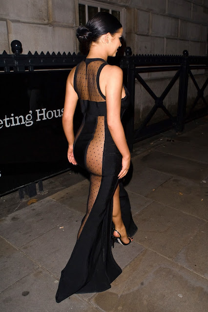 Demi Rose leaves the Beauty Awards in a transparent striped dress in London