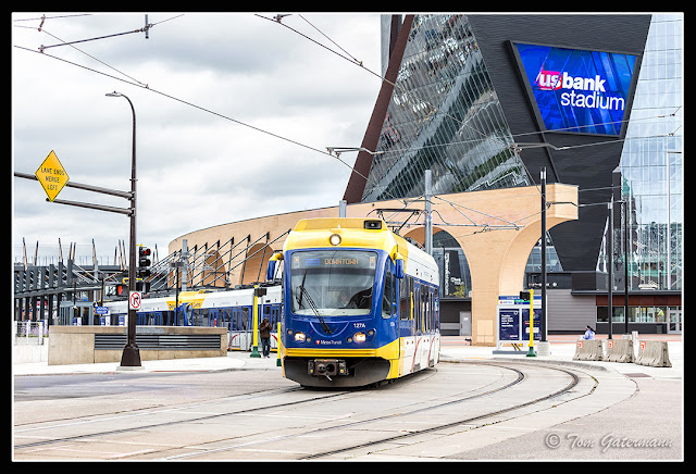 A Metro Transit light rail train departing US Bank Stadium in Minneapolis, MN