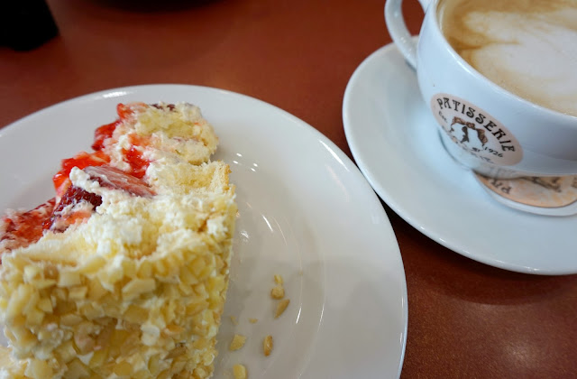 slice of cake and coffee at patisserie valerie