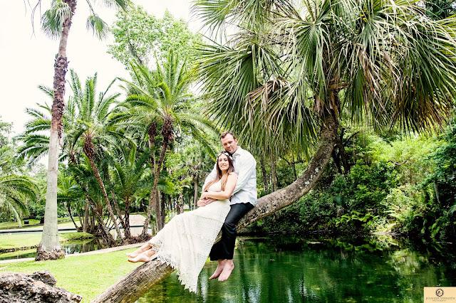couple balancing on palm tree
