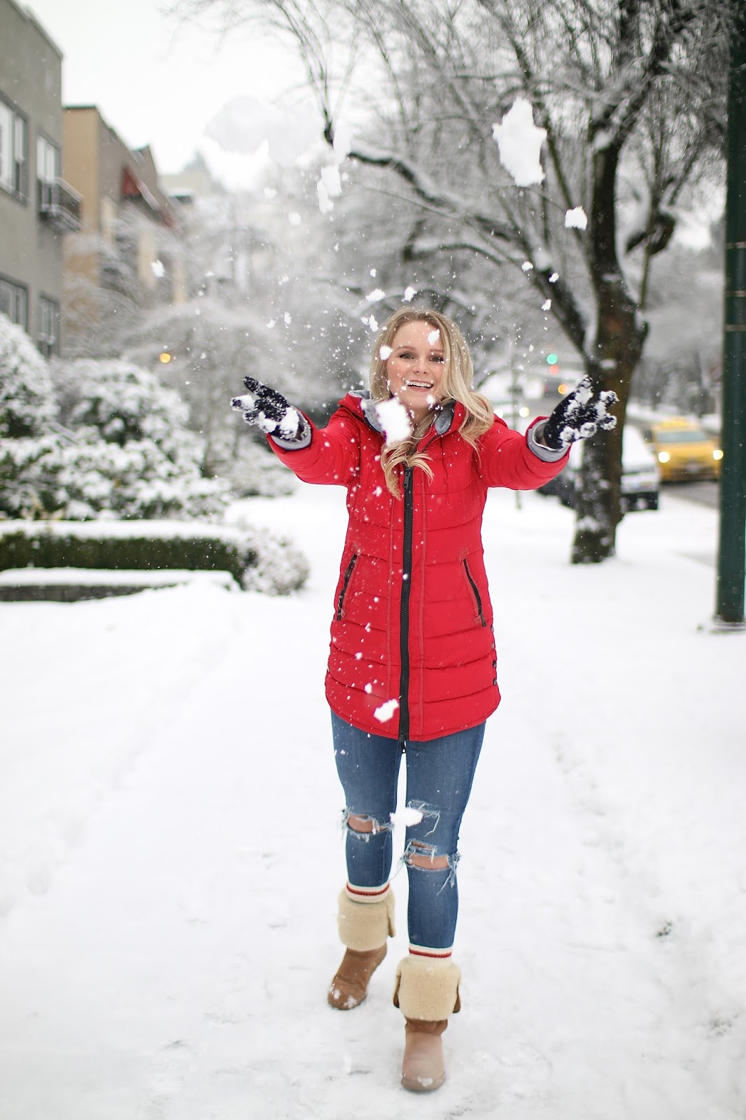 blonde women in red puffer jacket and ugg boots