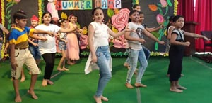 Students perform on stage during summer camp at Spring Dale